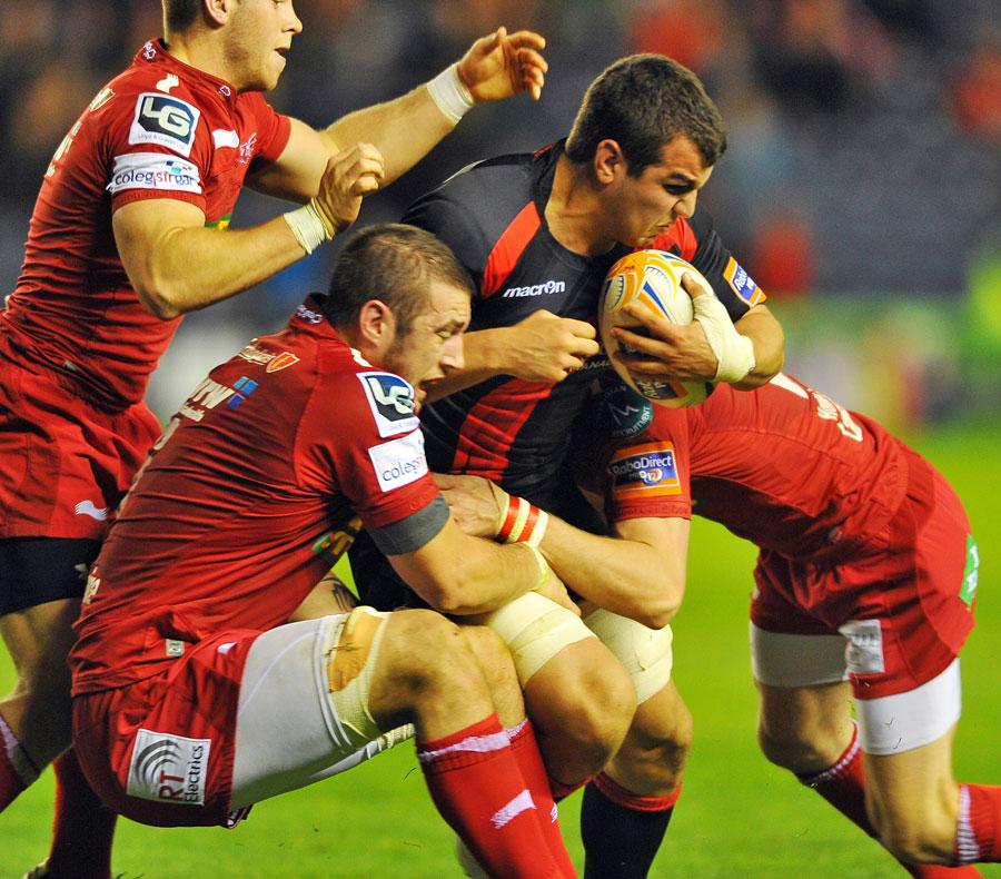 Edinburgh's Stuart McInally takes on the Scarlets' defence