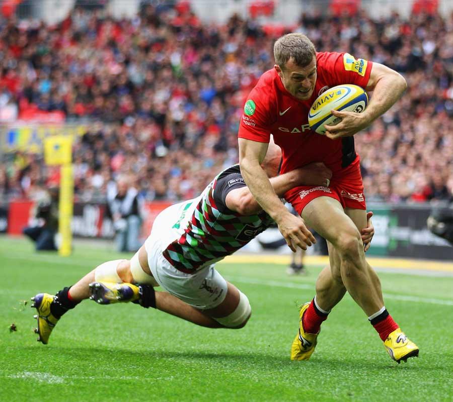 Saracens winger James Short attempts to break a tackle