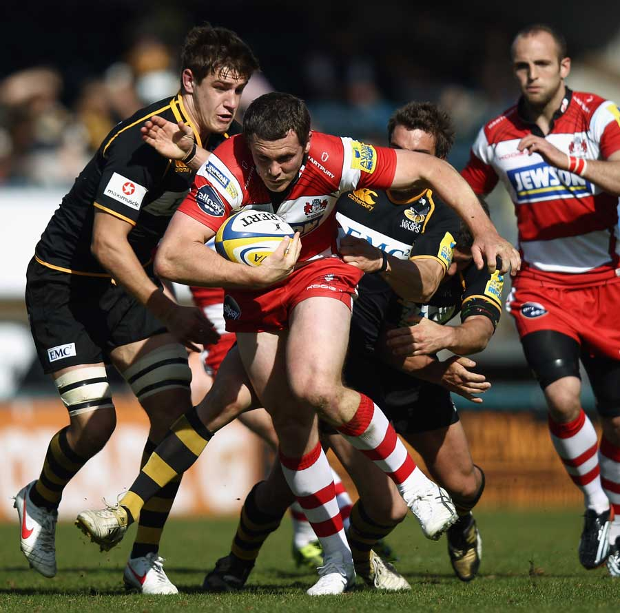 Gloucester centre Tim Molenaar is swamped by the Wasps defence