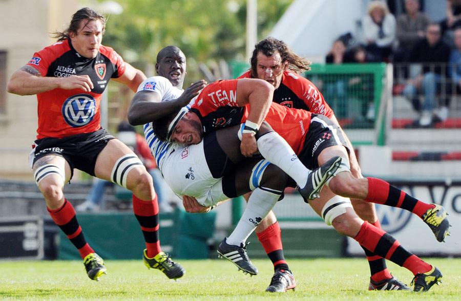 Toulon's Christophe Samson tackles Castres' Ibrahim Diarra