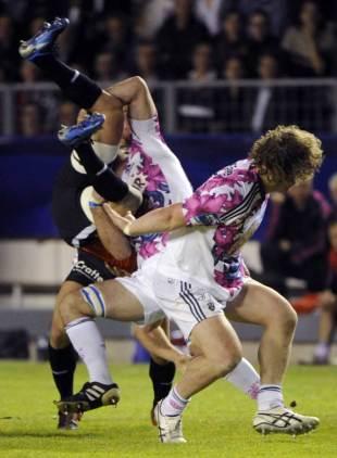 Stade's Alexandre Flanquart gets to grips with Toulon's Sebastien Tillous-Borde