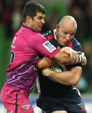 Melbourne Rebels centre Stirling Mortlock battles with Morne Steyn