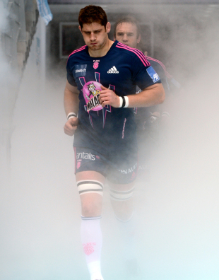 Stade Francais' lock Pascal Pape emerges from the smoke