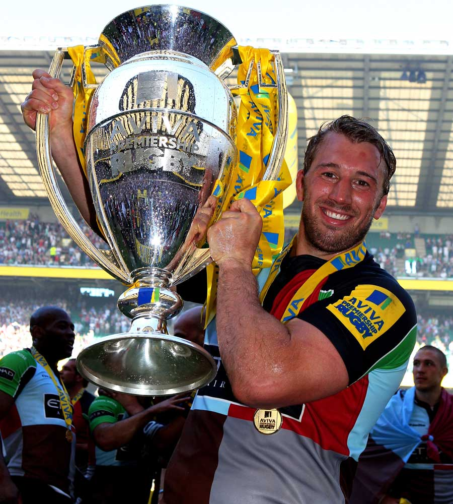 Harlequins skipper Chris Robshaw shows his delight with the Premiership trophy