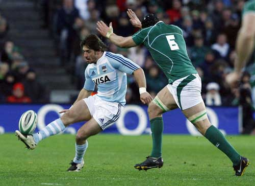 Ireland flanker Stephen Ferris tries to charge down Rafael Carballo's kick