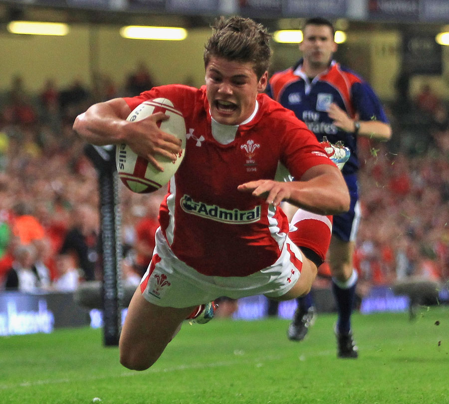 Wales' Harry Robinson dives over against the Barbarians