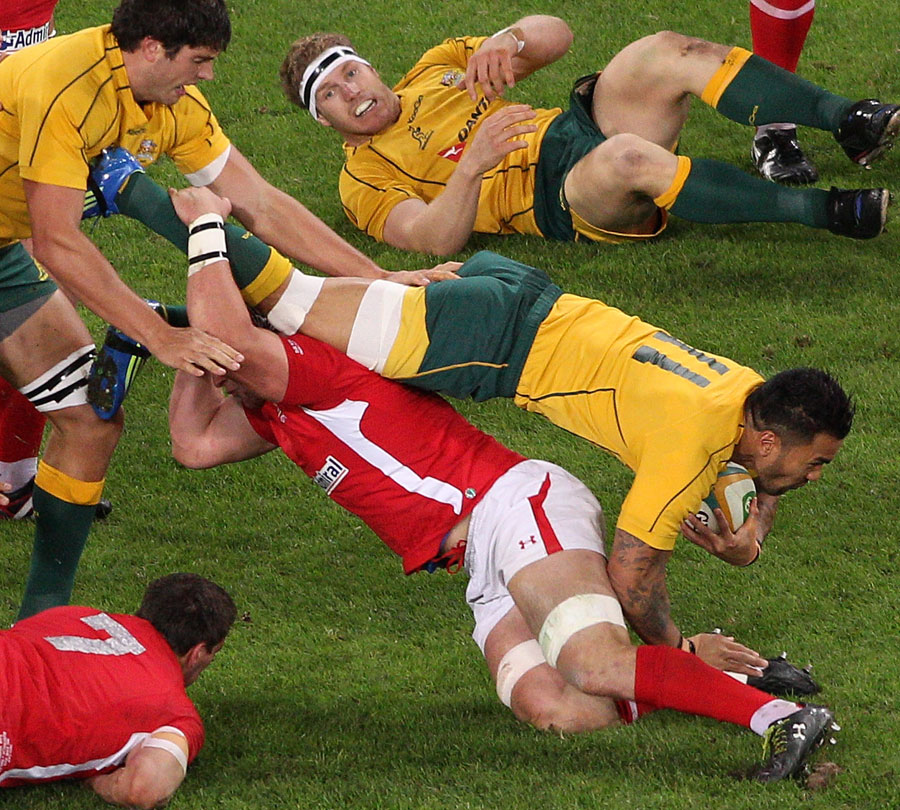 Australia's Digby Ioane is felled by the Wales defence