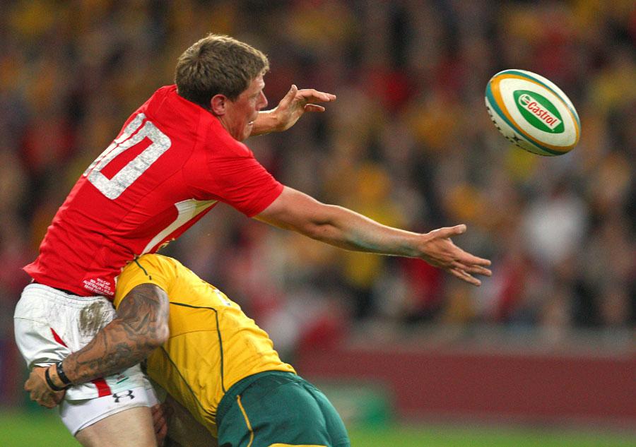 Wales' Rhys Priestland feels the force of Australia's Digby Ioane