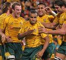Australia's Will Genia celebrates scoring a try