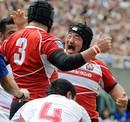 Japan's Yusuke Nagae celebrates a try