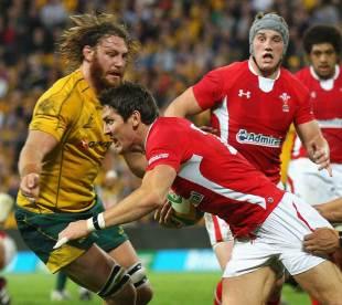 Wales fullback James Hook attempts to break a tackle, Australia v Wales, Suncorp Stadium, Brisbane, Australia, June 9, 2012