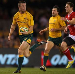 Australia's Rob Horne races away for the try