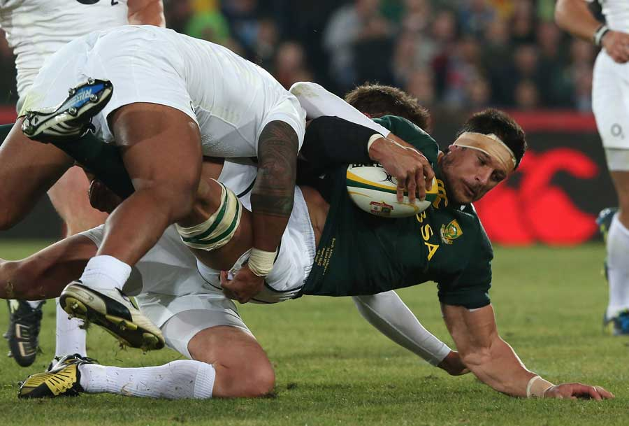 South Africa's Pierre Spies is halted by the England defence