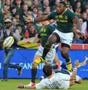 South Africa's Tendai Mtawarira hurdles Ben Foden