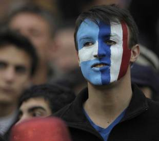 A fan displays split loyalties prior to kick-off