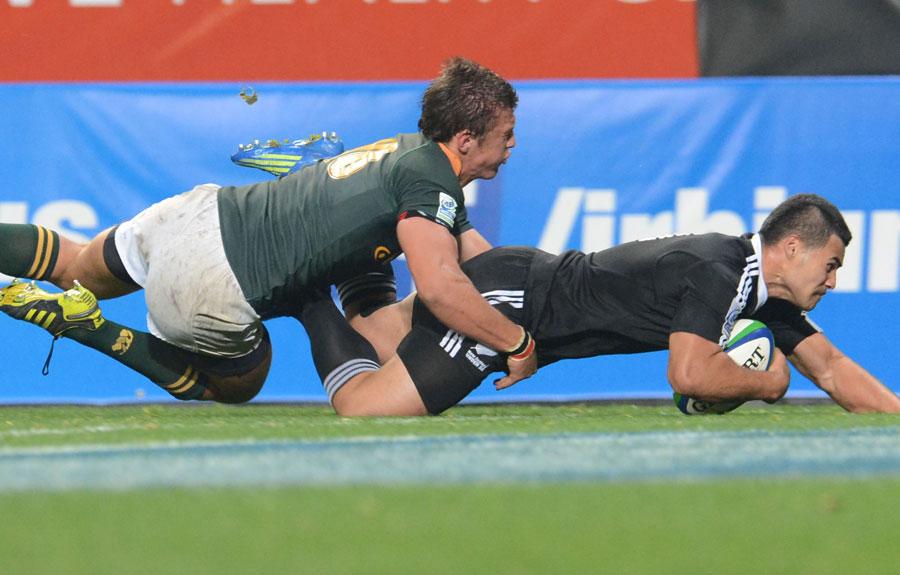 New Zealand's Milford Keresoma slides in to score