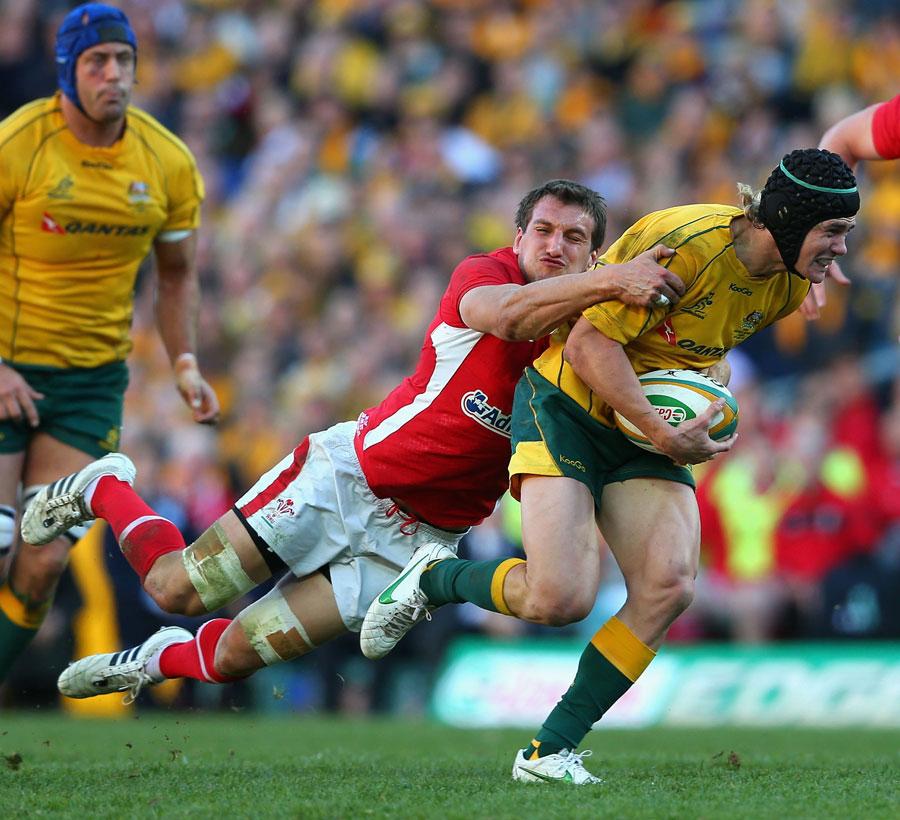 Berrick Barnes aims to break through a tackle