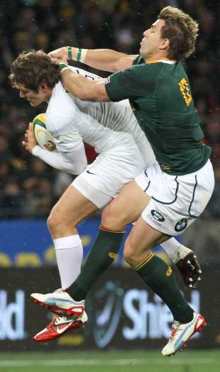 South Africa's Wynand Olivier tussles with Alex Goode