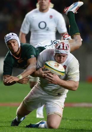 England's Thomas Waldrom plucks the ball under pressure from Gio Aplon