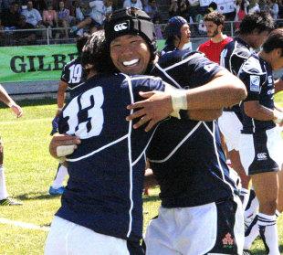 Japan's Yonghwi Kim and Rikiya Matsuda celebrate victory over Georgia