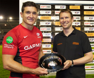 Saracens skipper Nils Mordt receives the silverware after a tough night's work at the sevens, J.P. Morgan Asset Management Sevens Series, The Stoop, London, England, July 14, 2012