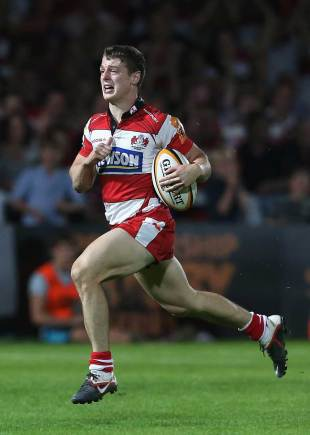 Gloucester's Ian Clark charges clear to score