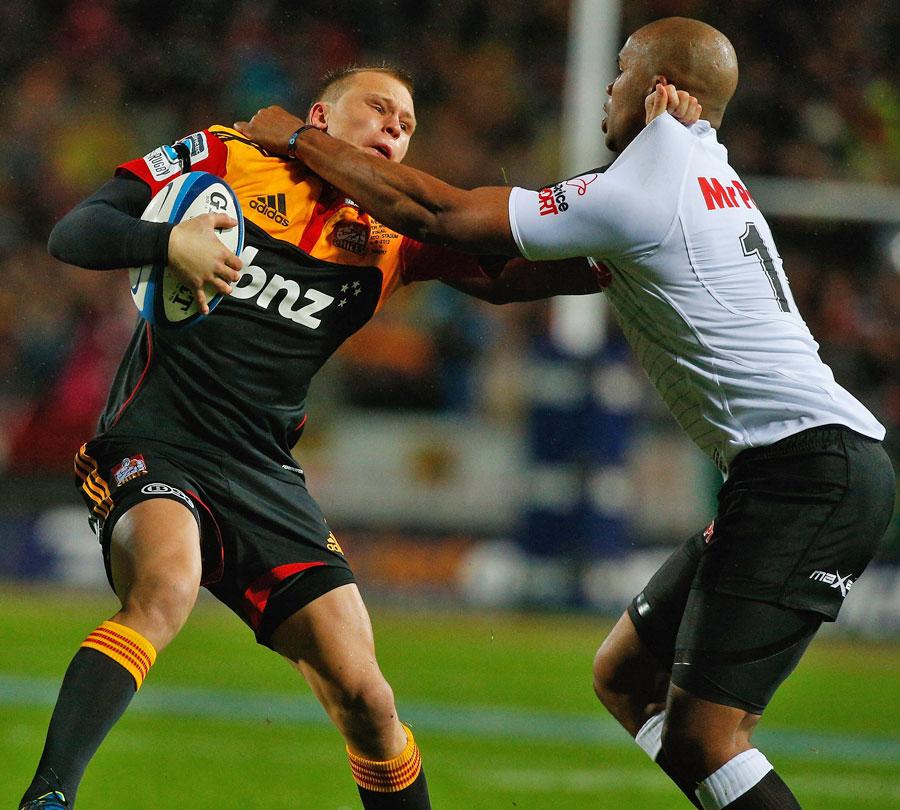 The Chiefs' Robbie Robinson fends off the Sharks' JP Pietersen