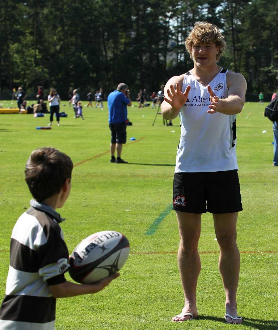 Edinburgh's Dave Denton teaches a child some skills