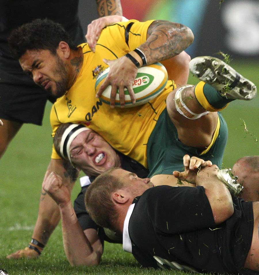 Australia's Digby Ioane lands on Brodie Retallick