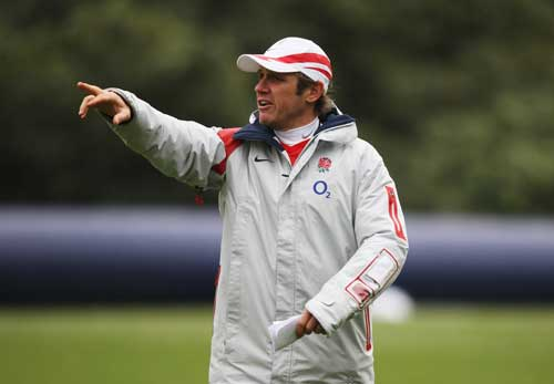Attack coach Brian Smith gives instructions during an England training session