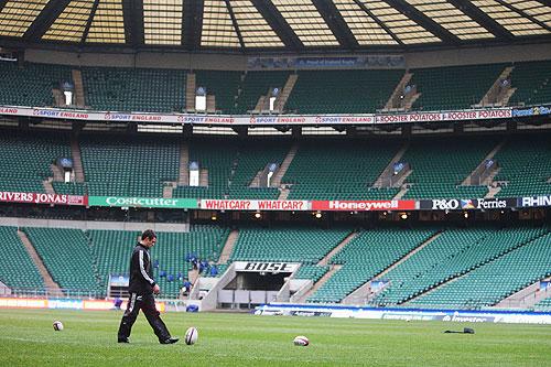 New Zealand's fly-half, Dan Carter, practises his kicking at Twickenham
