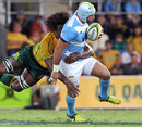 Australia's Radike Samo tackles Argentina's Juan Manuel Leguizamon