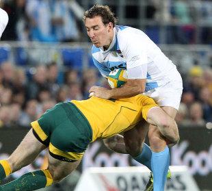 Argentina's Santiago Fernandez absorbs a tackle, Australia v Argentina, Rugby Championship, Skilled Park, Gold Coast, Australia, September 15, 2012