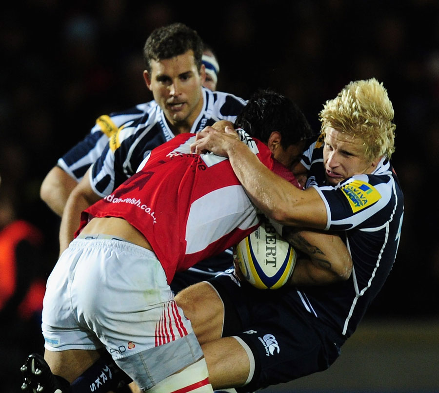 London Welsh's Daniel Browne knocks back Sale Sharks' David Seymour in the tackle