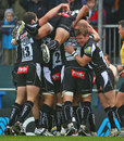 Exeter celebrate a try against Saracens