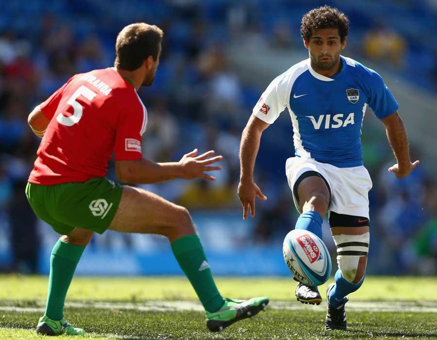 Argentina's Gaston Revol kicks around the Portugal defence