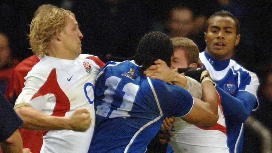 England's Lewis Moody and Samoa's Alesana Tuilagi brawl