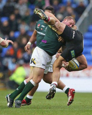 London Irish's David Paice tackles Quins' Maurie Fa'asavalu, London Irish v Harlequins, Aviva Premiership, Madejski Stadium, Reading, England, October 28, 2012