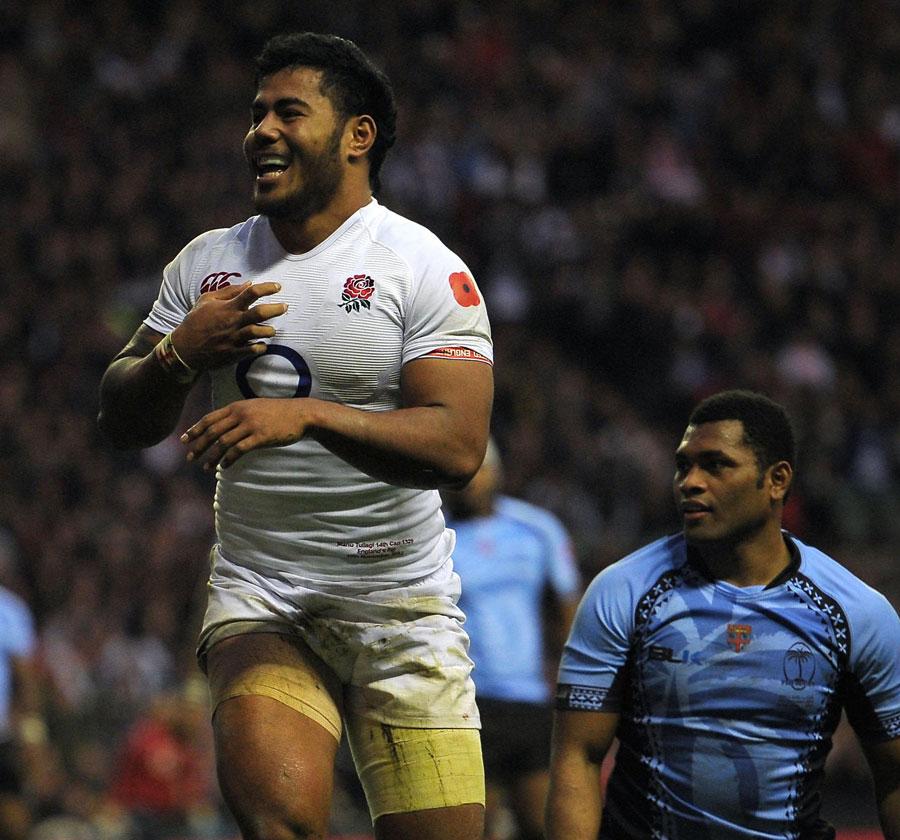 England's Manu Tuilagi celebrates scoring a try