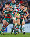 Leicester's George Ford evades the London Irish defence