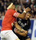 Scotland's Alastair Kellock feels the full force of the Tongan defending