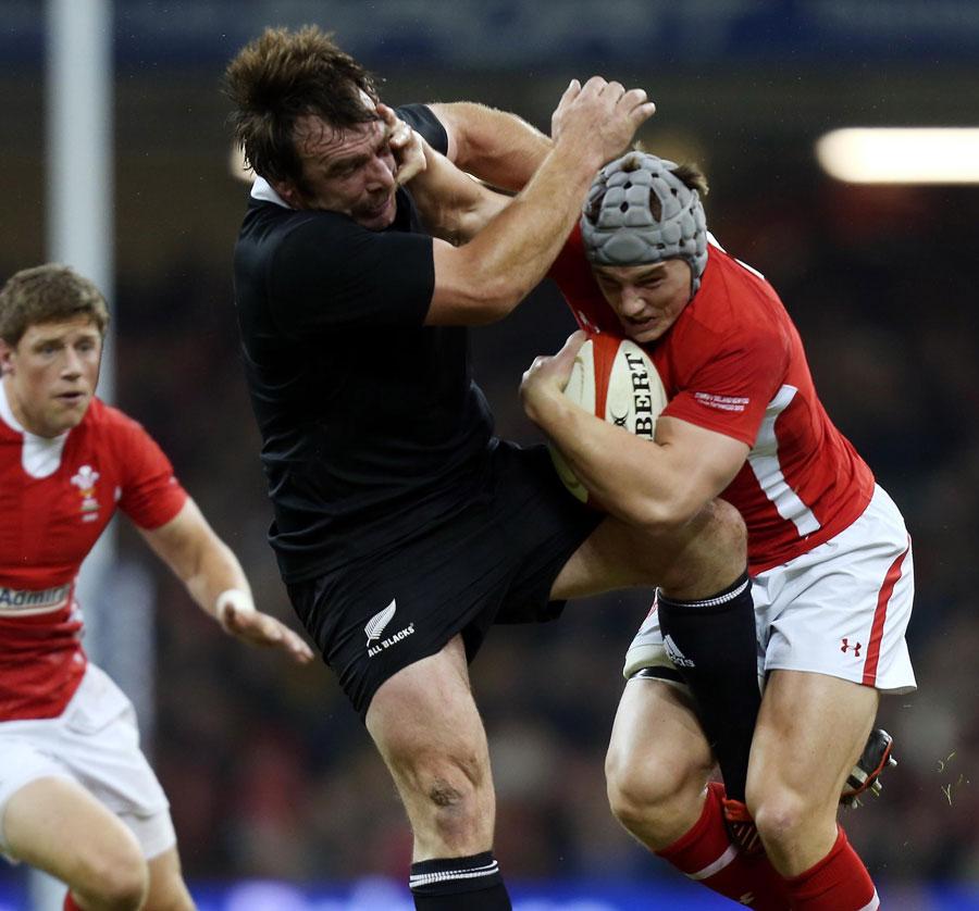 Jonathan Davies tries to shake off Andrew Hore