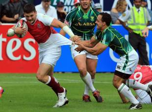 Paul Delport of South Africa tackles Jeff Williams of England