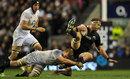 England's Chris Robshaw brings down New Zealand's Kieran Read