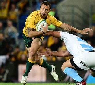 Australia's Quade Cooper dodges a tackle, Australia v Argentina, Rugby Championship, Skilled Park, Gold Coast, Australia, September 15, 2012