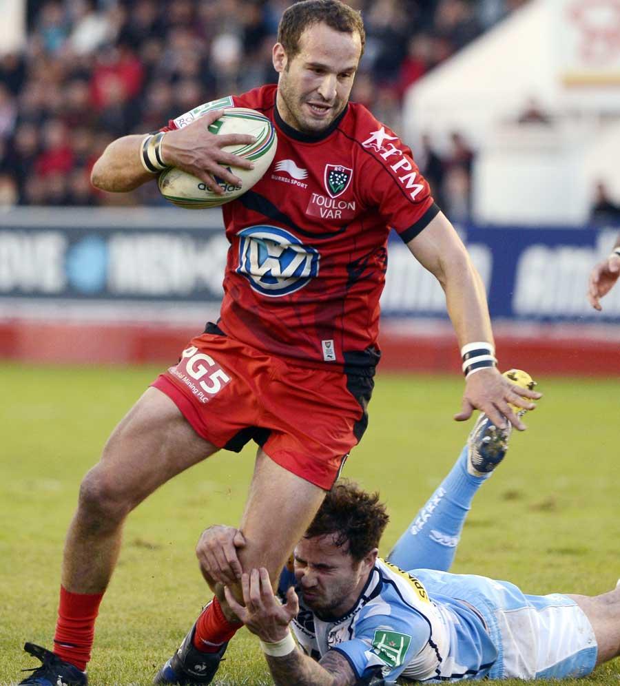 Toulon's Frederic Michalak darts past Danny Cipriani
