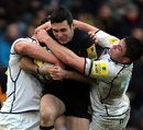 Wasps' Stephen Jones is wrapped up by two Sale defenders