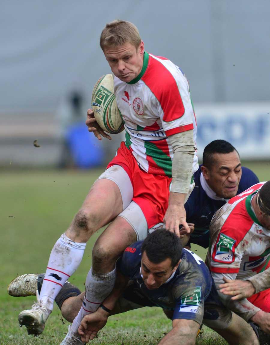 Biarritz's Iain Balshaw hurdles the Zebre tackler