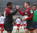 Saracens' Chris Ashton is congratulated on a try by Mako Vunipola