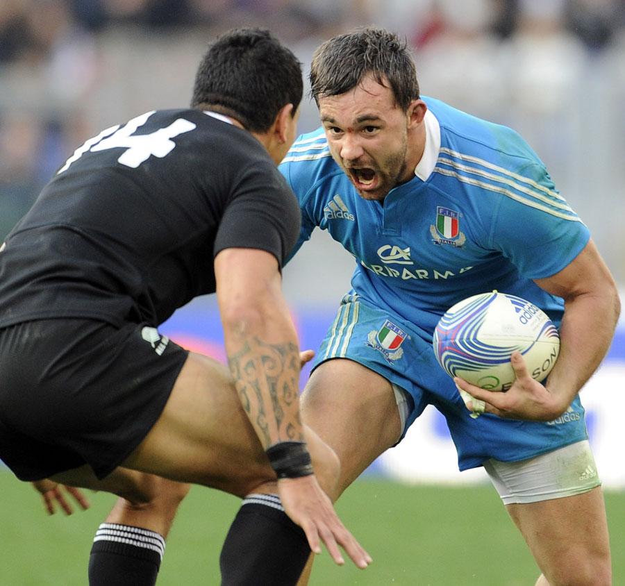 Italy's Simone Favaro runs at the New Zealand defence